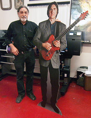 Alfred poses with a life-size cutout . . . So which one is Alfred?
